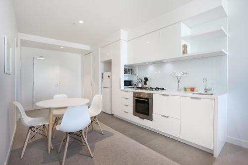 A kitchen or kitchenette at Eporo Tower