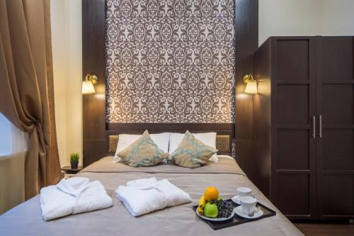Кровать или кровати в номере Отель Граф Толстой