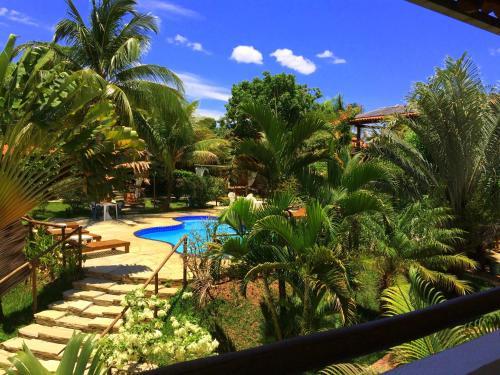 Vista de la piscina de Pousada Flores do Cerrado o alrededores