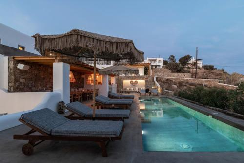 The swimming pool at or near Trinity Mykonos - Boutique Beachfront Hotel