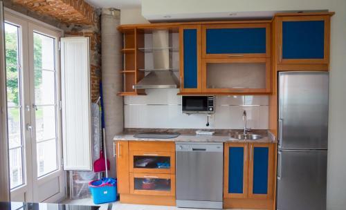 A kitchen or kitchenette at Apartamentos Playas de Noja