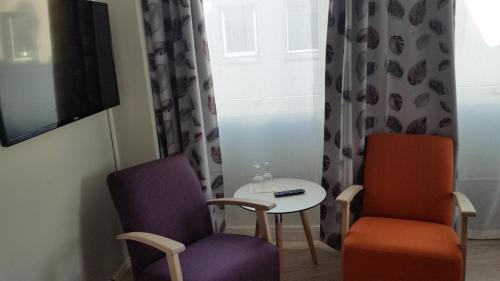 A seating area at Corner Hotell