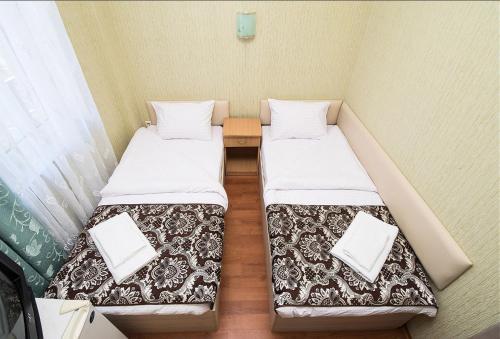 Кровать или кровати в номере Zirka Hotel