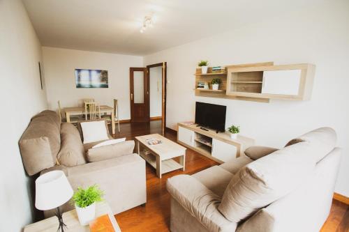 Zona de estar de Apartamentos Alday