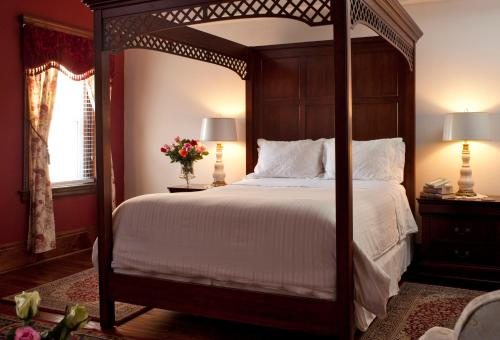 A bed or beds in a room at American Guest House