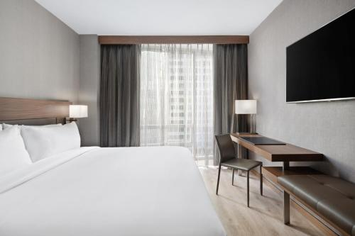 A bed or beds in a room at AC Hotel by Marriott New York Downtown