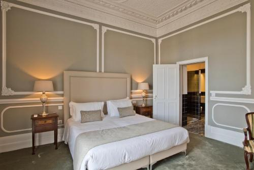 A bed or beds in a room at Casa da Moira