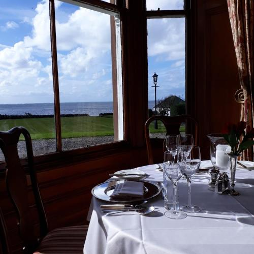 A restaurant or other place to eat at Knockinaam Lodge