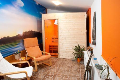 Ein Sitzbereich in der Unterkunft Pension Modrá Hvězda