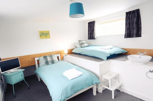 A bed or beds in a room at Southville Guest House