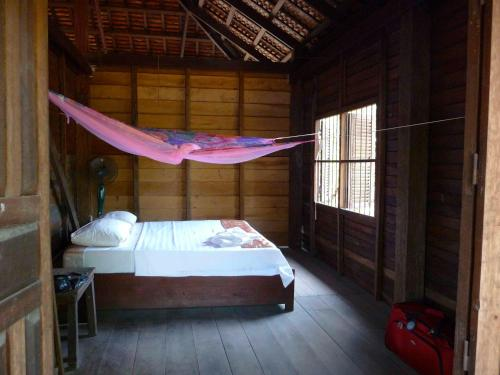 A bed or beds in a room at Koh Ker Jungle Lodge