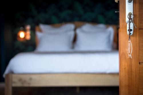 Un ou plusieurs lits dans un hébergement de l'établissement La Maison de Clementine