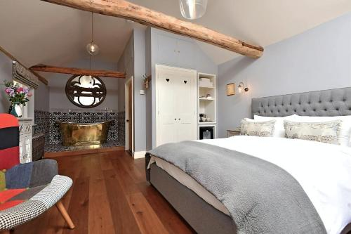 A bed or beds in a room at The Mill, Long Melford