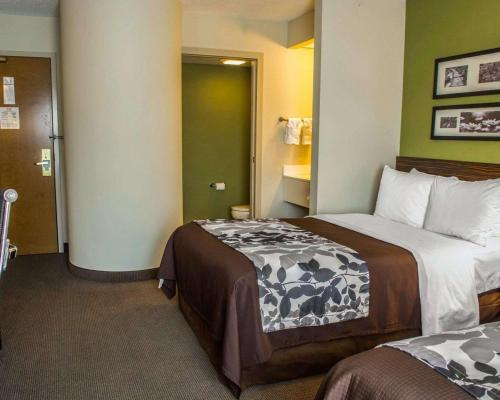 A bed or beds in a room at Sleep Inn Staunton