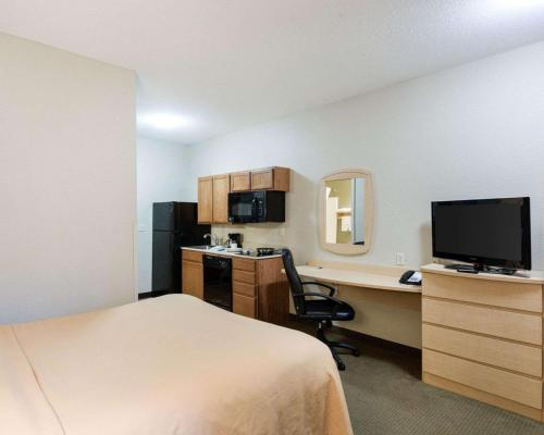 A television and/or entertainment center at Suburban Extended Stay Hotel Morgantown