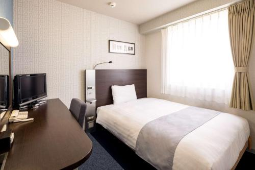 A bed or beds in a room at Comfort Hotel Saga
