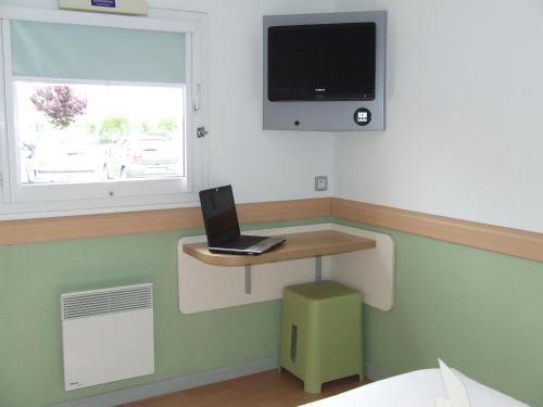 A television and/or entertainment center at ibis budget Bourges