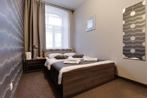 Кровать или кровати в номере All Dreams Rooms