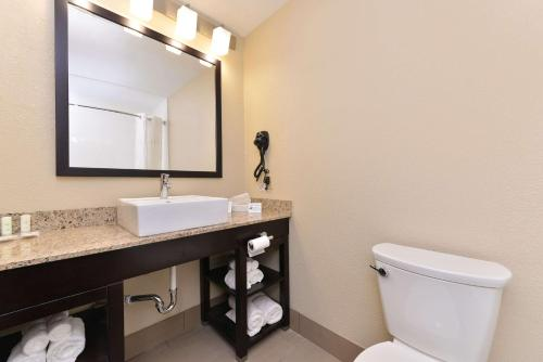 A bathroom at Comfort Suites East