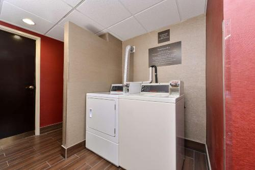 A kitchen or kitchenette at Comfort Suites East