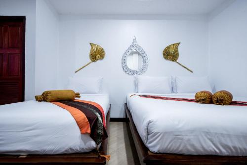 A bed or beds in a room at Chedi Home