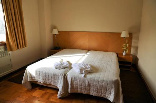 A bed or beds in a room at INATEL Santa Maria Da Feira