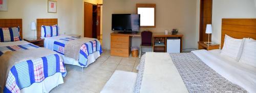 Cama o camas de una habitación en Convair Hotel
