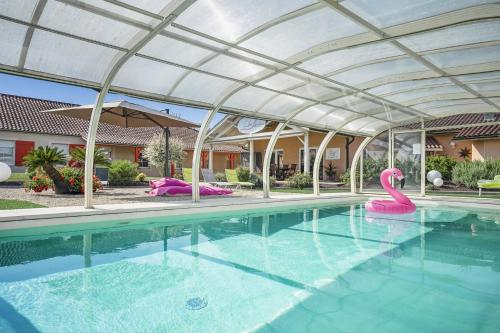 The swimming pool at or near The Originals Boutique, Hôtel Le Pillebois, Bourg-en-Bresse Nord (Inter-Hotel)