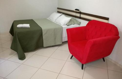 A bed or beds in a room at Mb Hotel