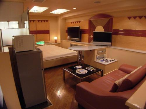 A television and/or entertainment centre at Hotel J House 1 (Adult Only)