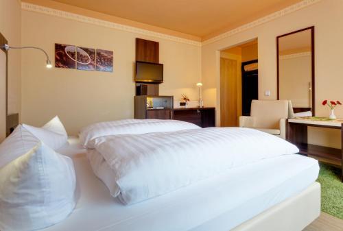 Ein Bett oder Betten in einem Zimmer der Unterkunft Alte Schleiferei