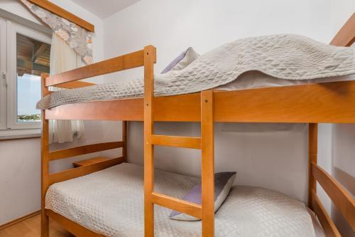 A bunk bed or bunk beds in a room at Villas Kampor