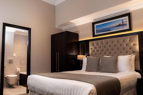 A bed or beds in a room at The County Aparthotel