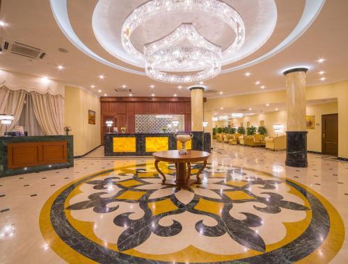 The lobby or reception area at Ramada by Wyndham Almaty
