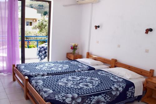 Ένα ή περισσότερα κρεβάτια σε δωμάτιο στο Ξενοδοχείο Ρόζμαρι