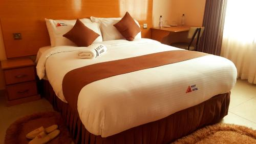 A bed or beds in a room at Pivot Hotel