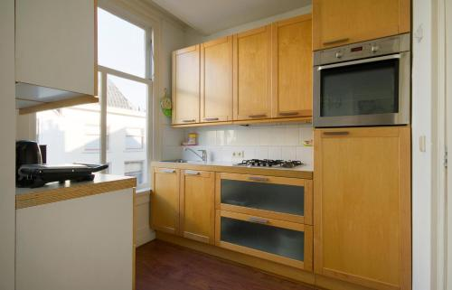 A kitchen or kitchenette at Corpus Apartment