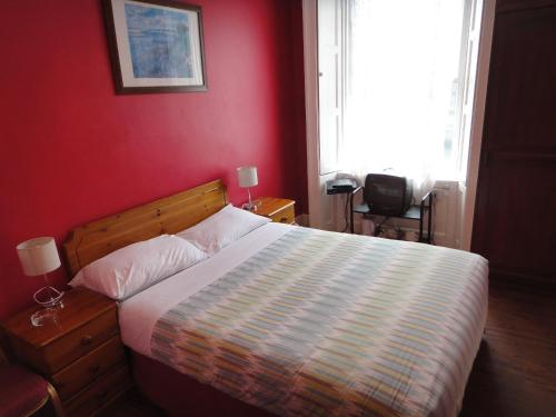 A bed or beds in a room at Inn on the Liffey Guesthouse