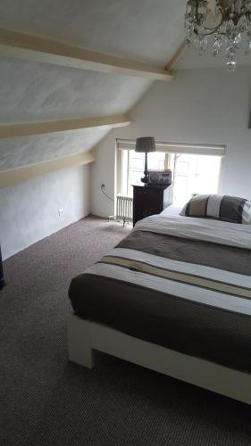 A bed or beds in a room at Appartement Reynaert