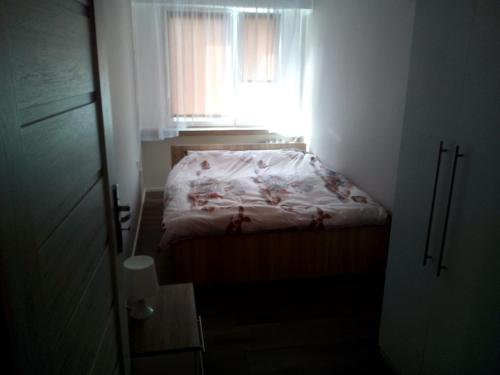 A bed or beds in a room at 11 Listopada 15/16