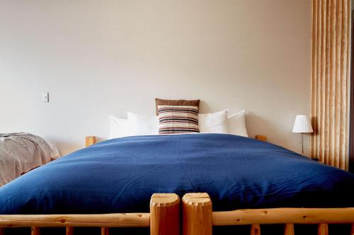 A bed or beds in a room at Canopy Cortina Lodge