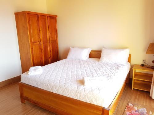 Giường trong phòng chung tại Viet Thanh Resort