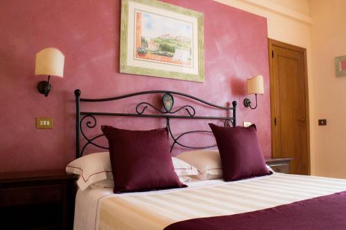 Letto o letti in una camera di Hotel Ristorante Tre Stelle