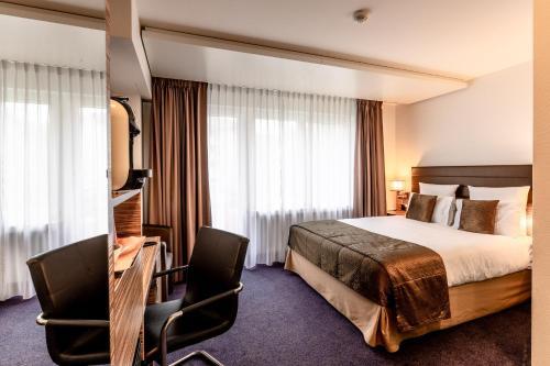 Ein Bett oder Betten in einem Zimmer der Unterkunft Mercure Stoller Zürich
