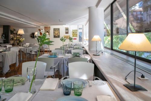 Ein Restaurant oder anderes Speiselokal in der Unterkunft Vincci Soma