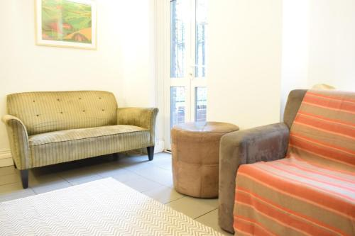A seating area at 2 Bedroom Property in the Heart of Angel