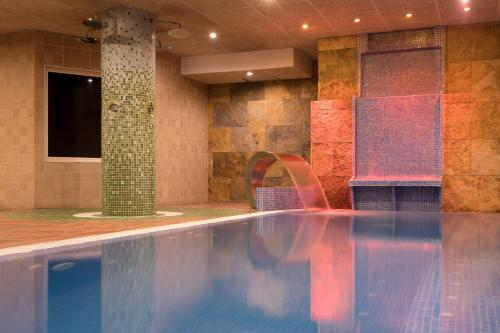 The swimming pool at or near htop Palm Beach & SPA