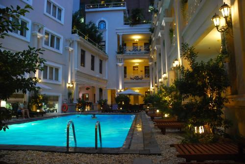The swimming pool at or close to Grand Hotel Saigon