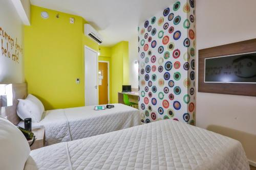A bed or beds in a room at IBIS Styles Vitoria Da Conquista