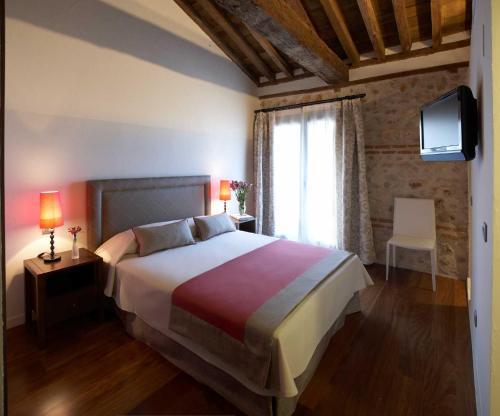 Cama o camas de una habitación en El Pontifical
